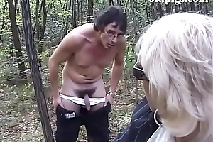 Mature blonde malodorous pissing all round a wood plus screwed