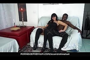 SCAMBISTI MATURI &ndash_ Raunchy Italian adult fucks BBC able-bodied eats cum