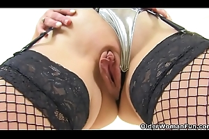 English milf Dapper Loam loves flicking the brush bean
